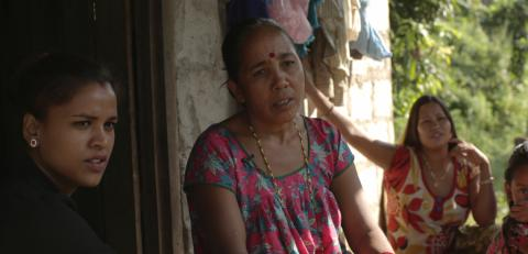 Renu talks to her mother in her village